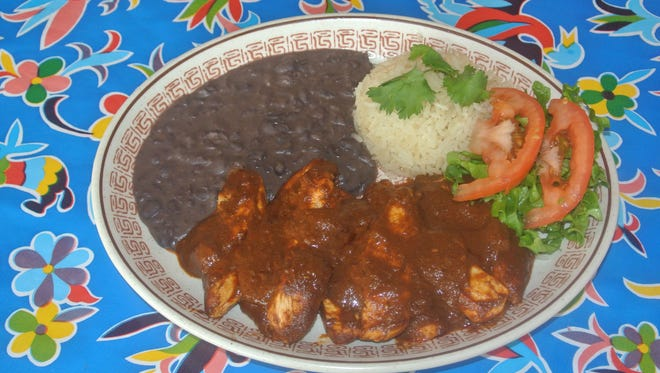 Chicken in mole will be on the menu at Tavo's Latin Fusion and Signature Cuisine, 5814 W. Blue Mound Road. The six-table restaurant opens May 22.