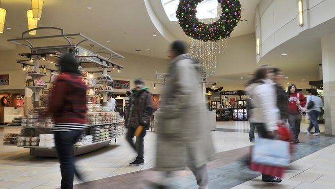 Shoppers whiz by in every direction, searching for Christmas gifts last holiday season at Crossroads Center.