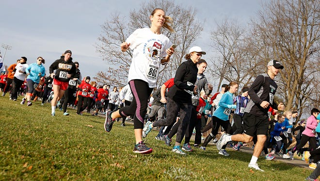 More than 800 runners and walkers take off from the start line around 9 a.m. Thursday during Notre Dame's Turkey Trot 5k race.