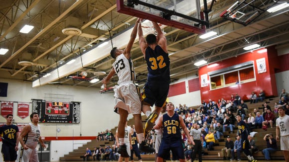 Elco's Colton Lawrence dunks the ball against Berks Catholic's Bryce Calloway as Elco defeated Berks Catholic 63-52 at Warwick High School on Monday, Feb. 22, 2016. Elco clinched a state playoff berth with the win.