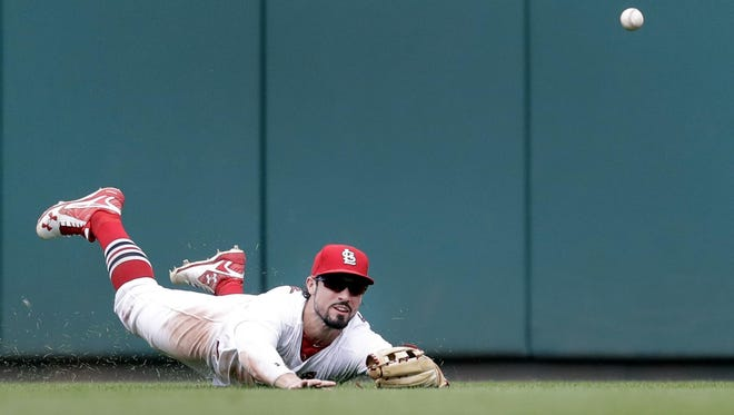 St. Louis Cardinals center fielder Randal Grichuk dives but can't reach an RBI triple by Chicago Cubs' Kris Bryant during the ninth inning Wednesday, in St. Louis.