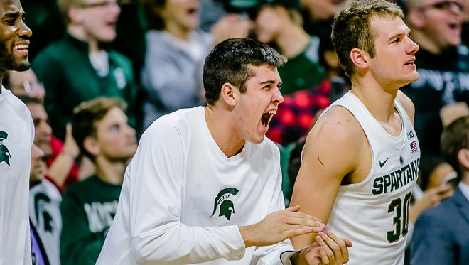 Connor George, center, of MSU, cheers on his teammates during their game with Oakland on Dec.21, 2016, in East Lansing.