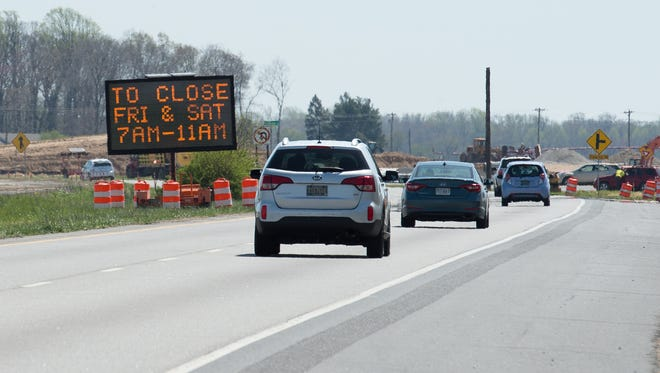A DelDot sign warns drives about the upcoming closure of the crossovers along Delaware Route 1 adjacent to DE Turf Sports Complex in Frederica.