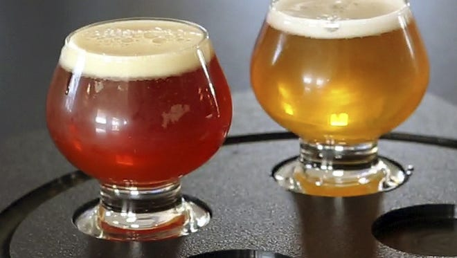 This May 7, 2015, file photo shows craft beers at the Maine Beer Company in Freeport, Maine.