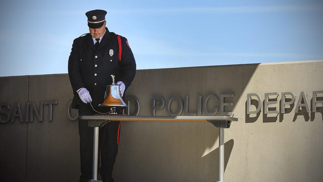 St. Cloud Fire Department Capt. Glen Koshiol silenced the bell, then stood in silence during A Day to Remember in 2016 at the St. Cloud Police Department. The ceremony marked the anniversary of the 9/11 terror attacks.
