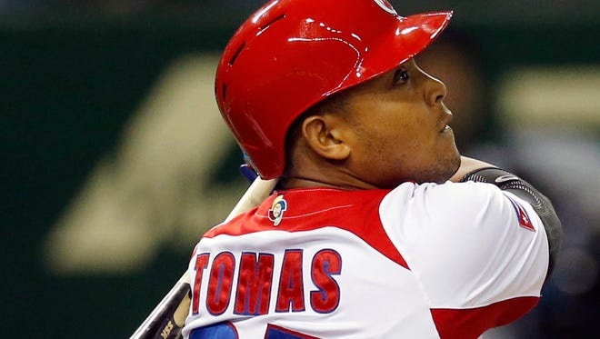 In this March 9, 2013, file photo, Cuba's Yasmany Tomas hits a three-run home run off Taiwan pitcher Yang Yao-hsun in the fourth inning of their World Baseball Classic second-round game in Tokyo.