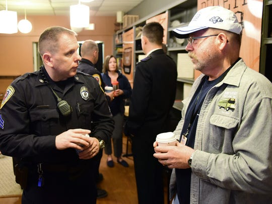 "Chambersburg Police Sgt. Jon Greenawalt, left, talks to John Hartman on Friday morning, March 11, 2016 at C & C Coffee Shop. Chambersburg Police held a ""Coffee with a Cop"" event to give locals a chance to meet and greet the men and women who patrol the streets."