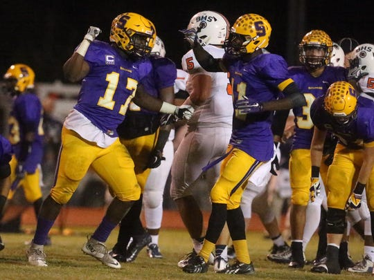 Smyrna's Deylon Williams (17) celebrates with teammates after making a play during a game earlier in the season. Williams has committed to UT-Martin.