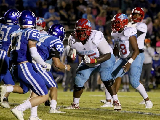 Hirschi's Johnny Taylor (75) and Isaiah Rankin (18)