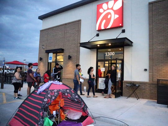 People taking part in a promotion for a new Chick-fil-A restaurant arrive early at 1300 Airway Blvd.