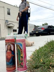 "Two candles are shown on the sidewalk near the Hancock Arms Apartments complex in Keansburg Thursday, July 13, 2017,  where the remains of 11-year-old AbbieGail ""Abbie"" Smith were found this morning behind."