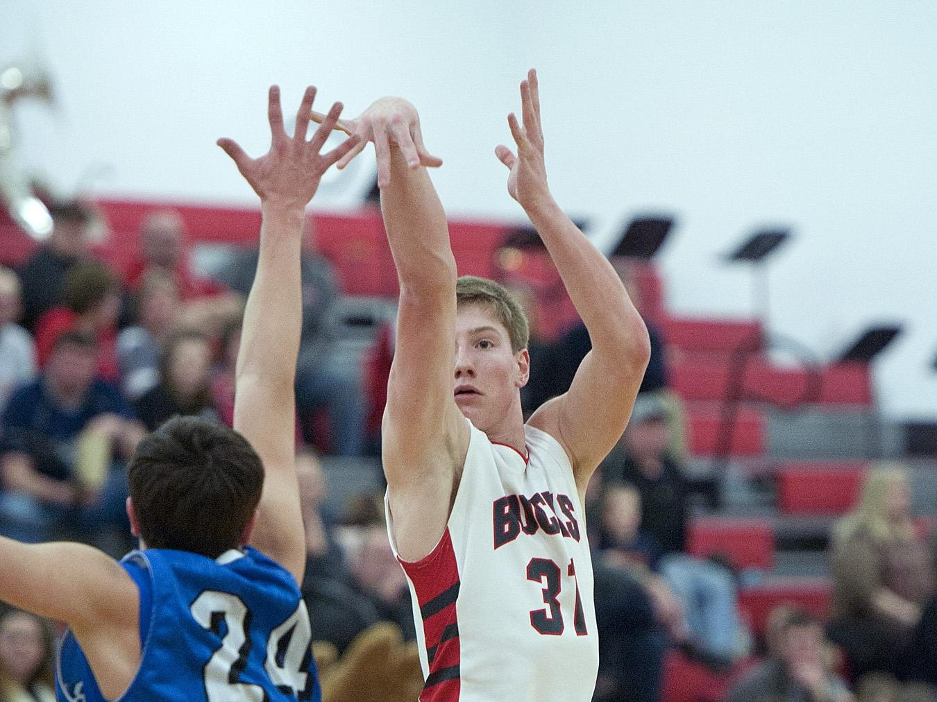 Buckeye Central's Grant Loy shoots a 3 against Wynford during the 2014-15 season.