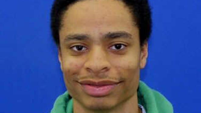 This photo released by the Howard County Police shows mall shooting suspect Darion Marcus Aguilar, 19, of College Park, Md.