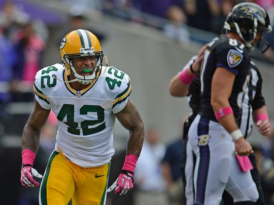 Green Bay Packers safety Morgan Burnett (42) reacts after the Packers stopped the Baltimore Ravens  on a fourth down.