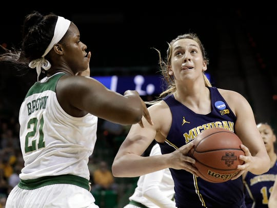 Michigan's Hallie Thome drives against Baylor's Kalani Brown in the first half.