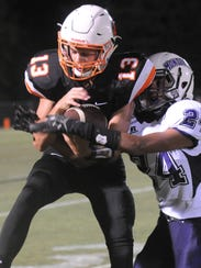 MTCS' Jackson Green breaks a tackle after a reception