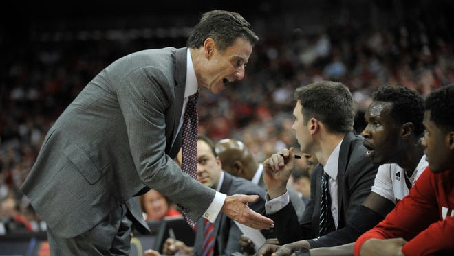 Louisville coach Rick Pitino gave instructions to Mangok Mathiang after committing a foul late inthe game.  Jan. 7, 2015.