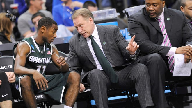 MSU head coach Tom Izzo talks to guard Lourawls Nairn Jr. on the bench against Virginia  during their NCAA game   in Charlotte, NC Sunday 3/22/2015.