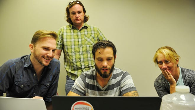 Jeremy Grondahl, left, Peter Connolly, back, Seth Dorris and Rhonda Eisenhaur, far right, work on an online game in their small group at Nashville Software School on Sept. 9, 2015.