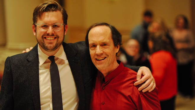 """Composer Robert Honstein and Present Music artistic director Kevin Stalheim celebrate the premiere of Honstein's """"Book of Hours."""""""