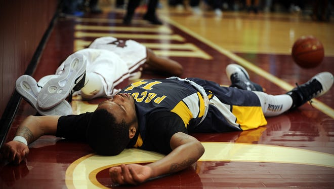 Pocomoke's Tyrone Matthews lays on the court after being fouled at the rim on Tuesday, Feb. 28, 2017 at Snow Hill High School.