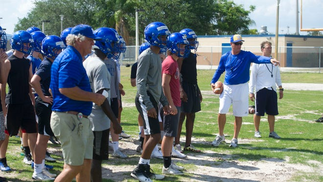 """Martin County High School football coach Bill Cubit lead the Tigers during the first day of spring practice Monday in Stuart. """"All I ask you do, is when the whistle blows, run,"""" Cubit instructed the team before the start of practice. The new head coach, who first coached the Tigers from 1986-88, told the team the goal for the season is to win the state championship and repeatedly said, """"know what you want."""""""