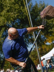Chad Thompson, of Albuquerque, competes in the sheaf