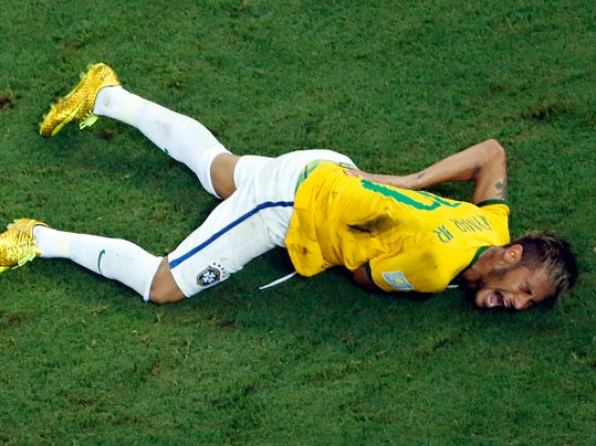 FILE - In this Friday, July 4, 2014 file photo, Brazil's Neymar grimaces in pain during the World Cup quarterfinal soccer match between Brazil and Colombia at the Arena Castelao in Fortaleza. Barcelona says Brazil striker Neymar has returned to training after passing a medical exam as he continues his recovery from a fractured vertebra. The Brazilian striker trained away from his teammates on Tuesday, Aug. 5, 2014,  after being examined by team doctors. (AP Photo/Fabrizio Bensch, Pool, File)