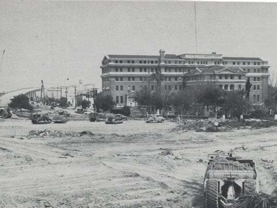 The Nueces County Courthouse as the route for the Harbor Bridge is built in the late 1950s.