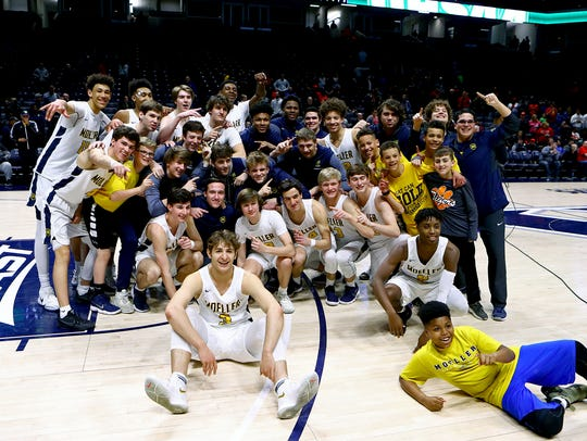 Moeller players celebrate after winning the OHSAA Regional