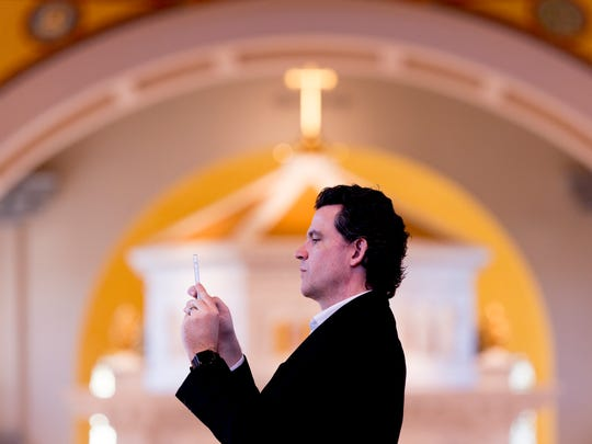 Glenn Kahler, director of Music and Liturgy, takes a photo of his group during preparations at the Mass and Rite of Dedication of the Cathedral of the Most Sacred Heart of Jesus in Knoxville, Tennessee on Friday, January 1, 2016. After nearly three years of construction, the 28,000-square-foot domed cathedral opened to a noon mass attended by more than 1,000 people.