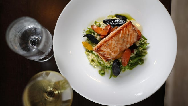 The Faroe Island salmon with parsnip puree, couscous, snow peas and white balsamic beurre blanc at Cinque.