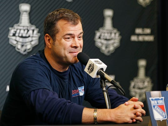 New York Rangers head coach Alain Vigneault speaks during a press conference at Madison Square Garden in New York, Tuesday, June 10, 2014.  The Los Angeles Kings have a 3-0 lead over the Rangers in the Stanlewy Cup Finals. (AP Photo/Kathy Willens)