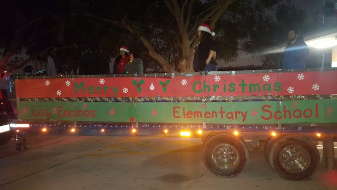 The staff at Los Encinos Elementary gather for soundcheck aboard their carol trailer Wednesday evening.
