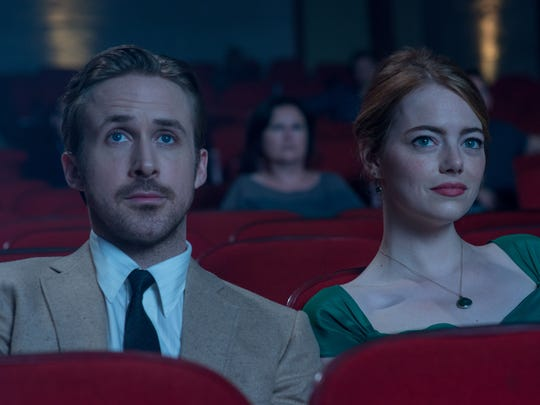 Ryan Gosling and Emma Stone get closer in 'La La Land.'