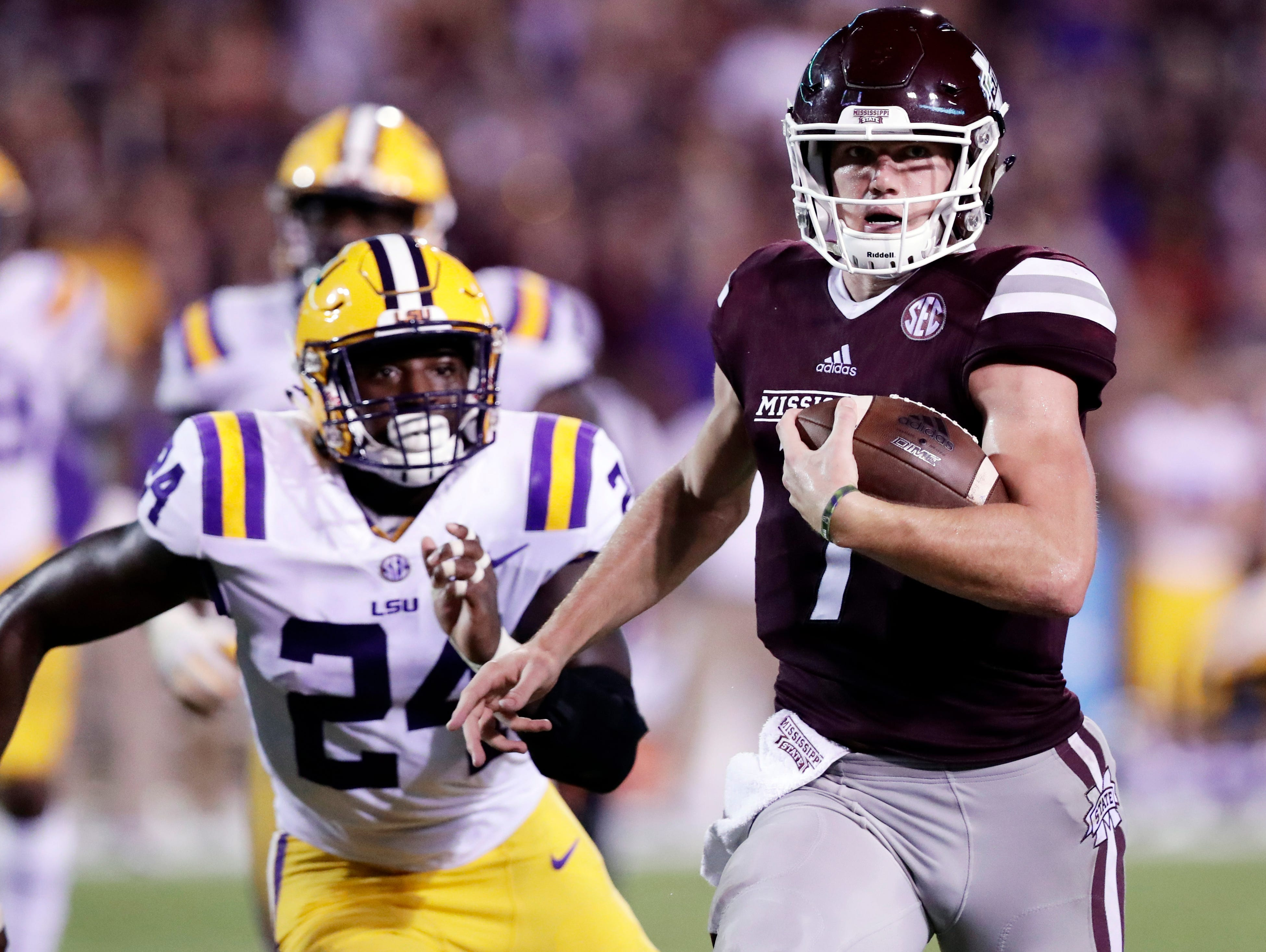Mississippi State quarterback Nick Fitzgerald (7) sprints past LSU linebacker Tyler Taylor (24) for a first down during the second half of their NCAA college football game against LSU in Starkville, Miss., Saturday, Sept. 16, 2017. Mississippi State won 37-7. (AP Photo/Rogelio V. Solis)
