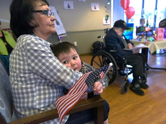 Alfred's daughter-in-law, Gloria Pappalardo holds her grandson, and Alfred's great-grandson, 22 month old Drake Stephenson, who looks like he could use a nap.