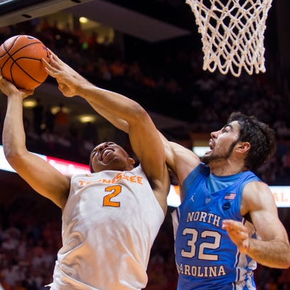 Tennessee forward Grant Williams (2) fights to attempt