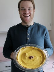 Kyle Griffith shows off the vegan pumpkin pie he made for his family for Thanksgiving.