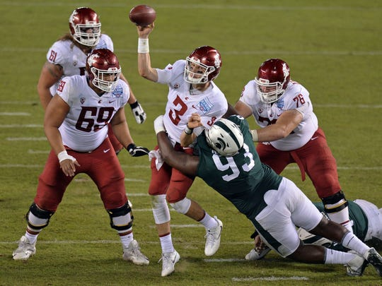 Washington State quarterback Tyler Hilinski (3) is