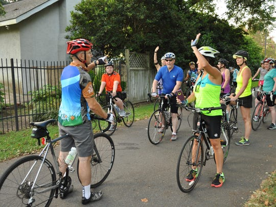 Mike Hopkins asks cyclists training for Le Tour de Bayou Saturday morning to raise their hands if it was their first time to ride with a group.