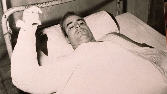 This is an undated file photo of Sen. John McCain, R-Ariz., lying injured as a prisoner of war in North Vietnam. It was among 4,000 photos and documents given to a U.S. delegation by Hanoi. McCain was a U.S. Navy pilot downed in Vietnam in 1967.