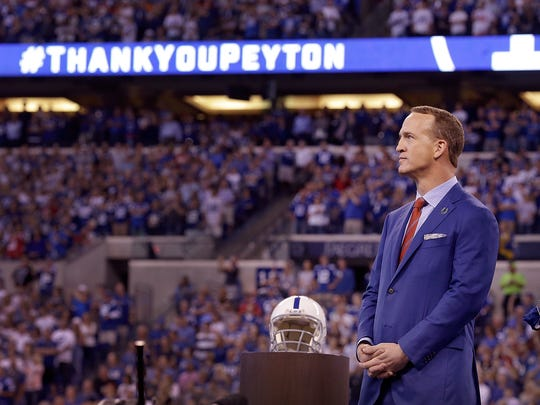 Former Indianapolis Colts Peyton Manning looks on watching a video in his honor at half time of the Colts game against the San Francisco 49ers Lucas Oil Stadium, Oct 8, 2017. Manning had his #18 jersey retired by the Colts was added to the Colts Ring of Honor.