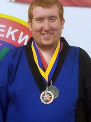 Joseph Daniels with his taekwondo medals.