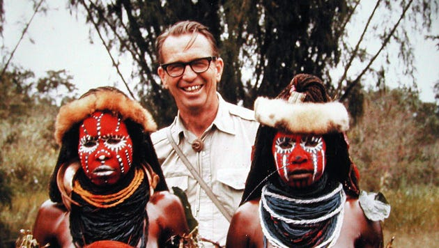 Earl Brockelsby, founder of Reptile Gardens in Rapid City, poses with natives during a visit to New Guinea. He died in 1993.