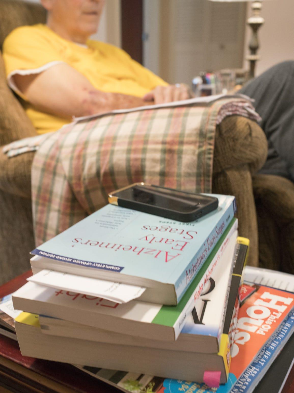 Books on Alzheimer's disease sit near Harvey's brown