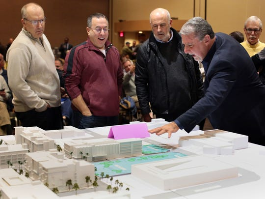 Palm Springs Councilman J.R. Roberts, right, talks over a model of the planned downtown Palm Springs during a development study session at the Palm Springs Convention Center.