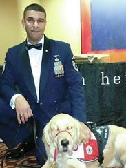 Wounded veteran Ian Williams poses with his service