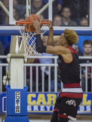 New Albany High School senior Romeo Langford (1) slam dunks the ball during the first half an IHSAA varsity basketball game at Carmel High School, Saturday, December 16, 2017.