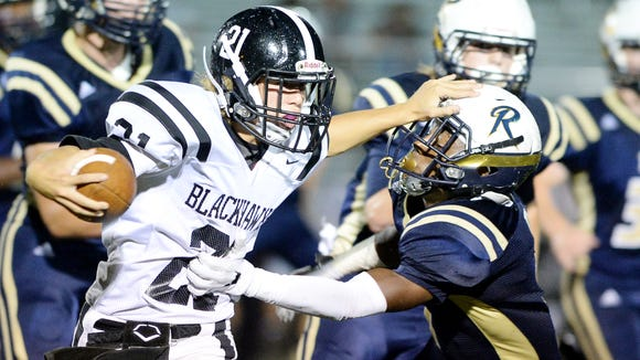 North Buncombe quarterback Caden Higgins (21) is out for 6-8 weeks because of a broken ankle.